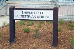 Timber signage to match the bollards and fencing