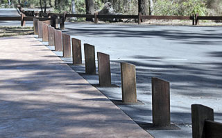 Timber traffic barrier, bollards from Outdoor Structures Australia